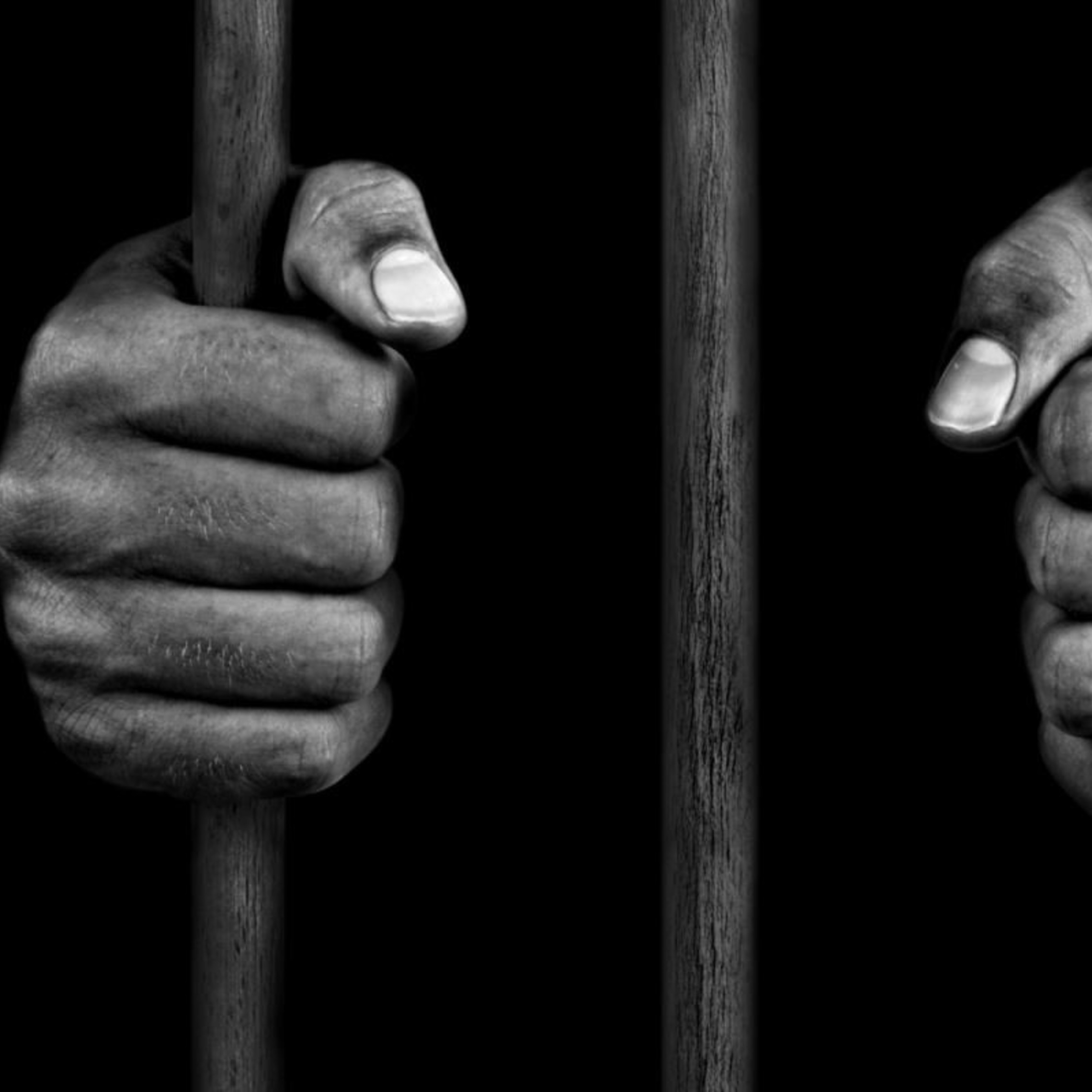 Death Penalty Hands On Bars